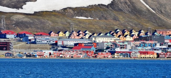 Colourful Longyearbyen houses seen from the sea
