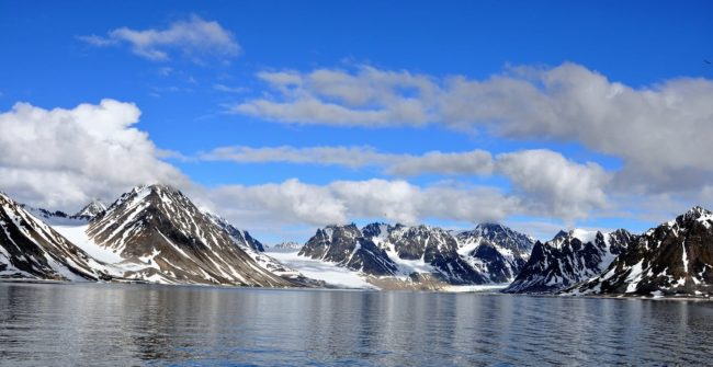 A panorama of glaciers and peaks in Spitsbergen, Svalbard, taken from the boat