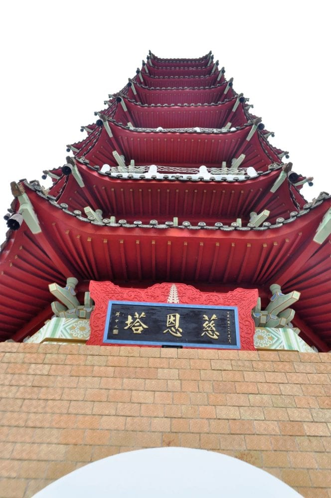 looking upwards at a red pagoda at Sun Moon Lake Taiwan