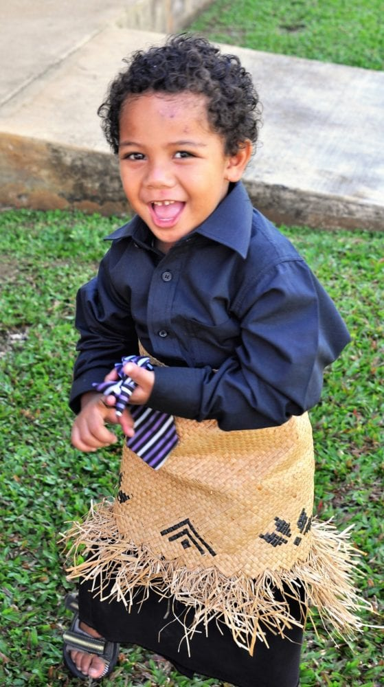 A Tongan boy in his woven Sunday apron