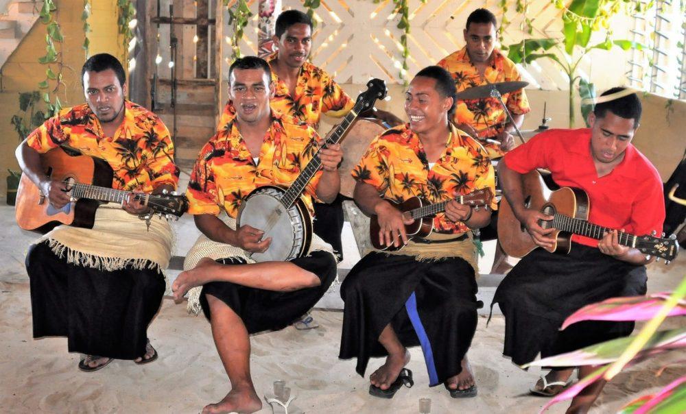 Tongan musicians playing at Sunday lunch in Tonga