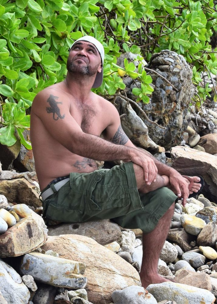 My tattooed Samoan guide Rory Junior on the beach in his shorts
