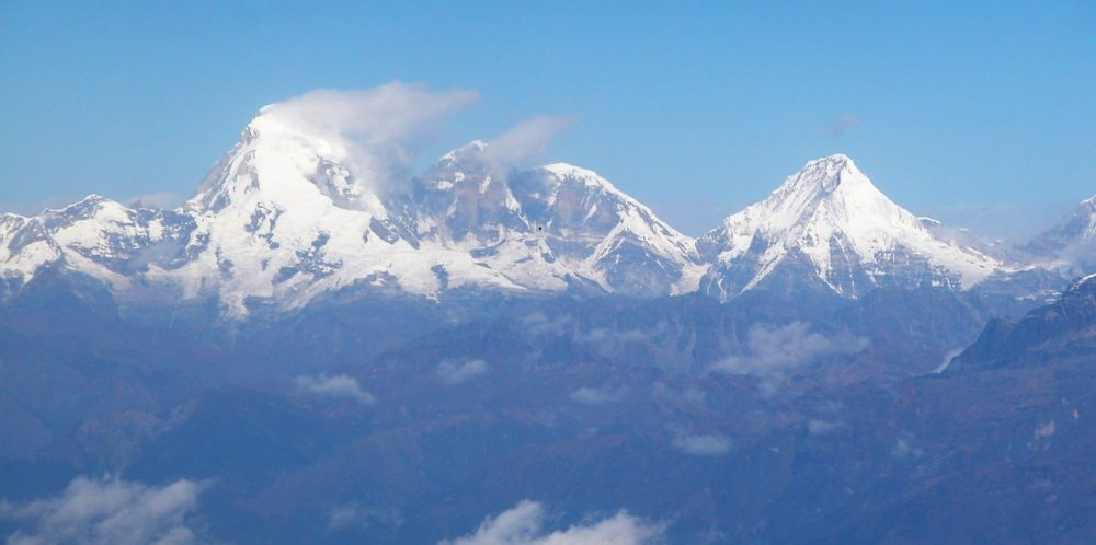 Everest amidst other Himalayan peaks taken from the plane