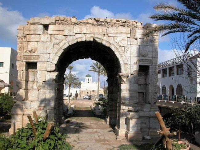 The arch of Marcus Aurelius frames a mosque, Tripoli