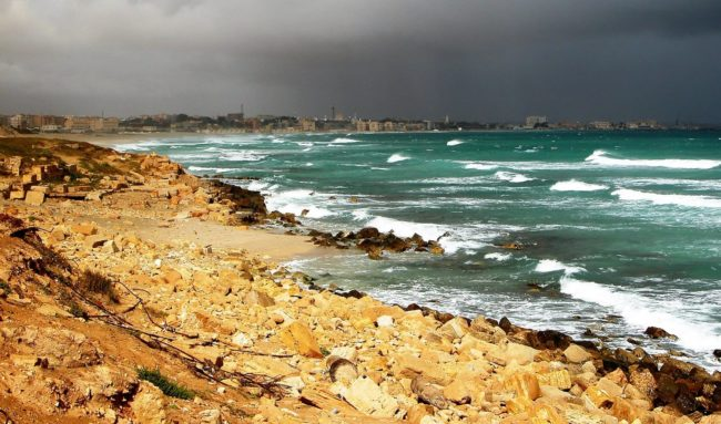 Waves on the turquoise waters of Tripoli Bay