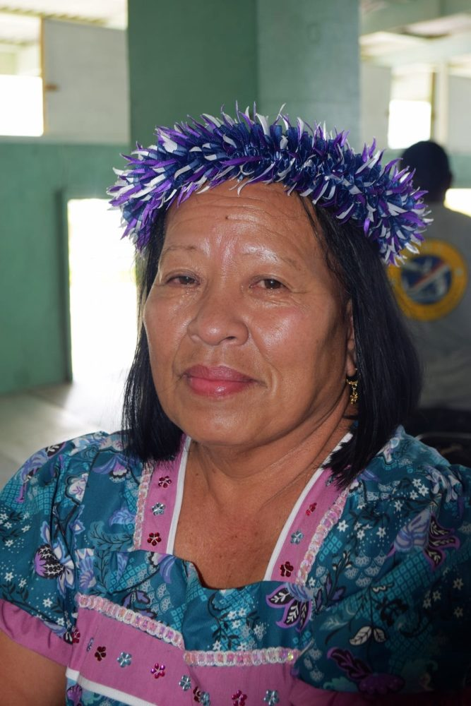 A portrait of a lady from the Marshall Islands with a garland on her head