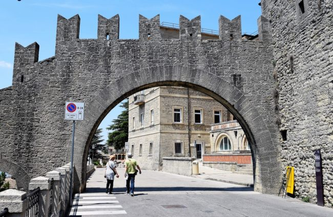 An arched entrance to the The Guaita Fortress overlooking San Marino city