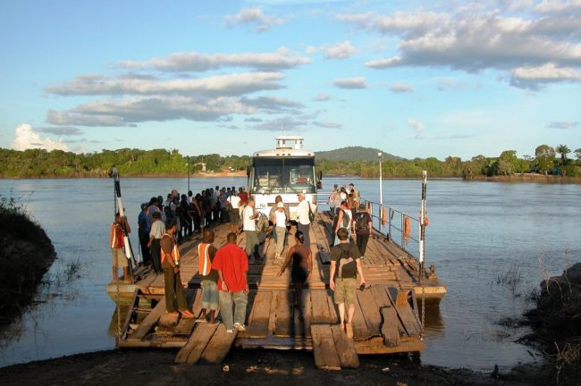 Passengers walking onto the river ferry in Guyana
