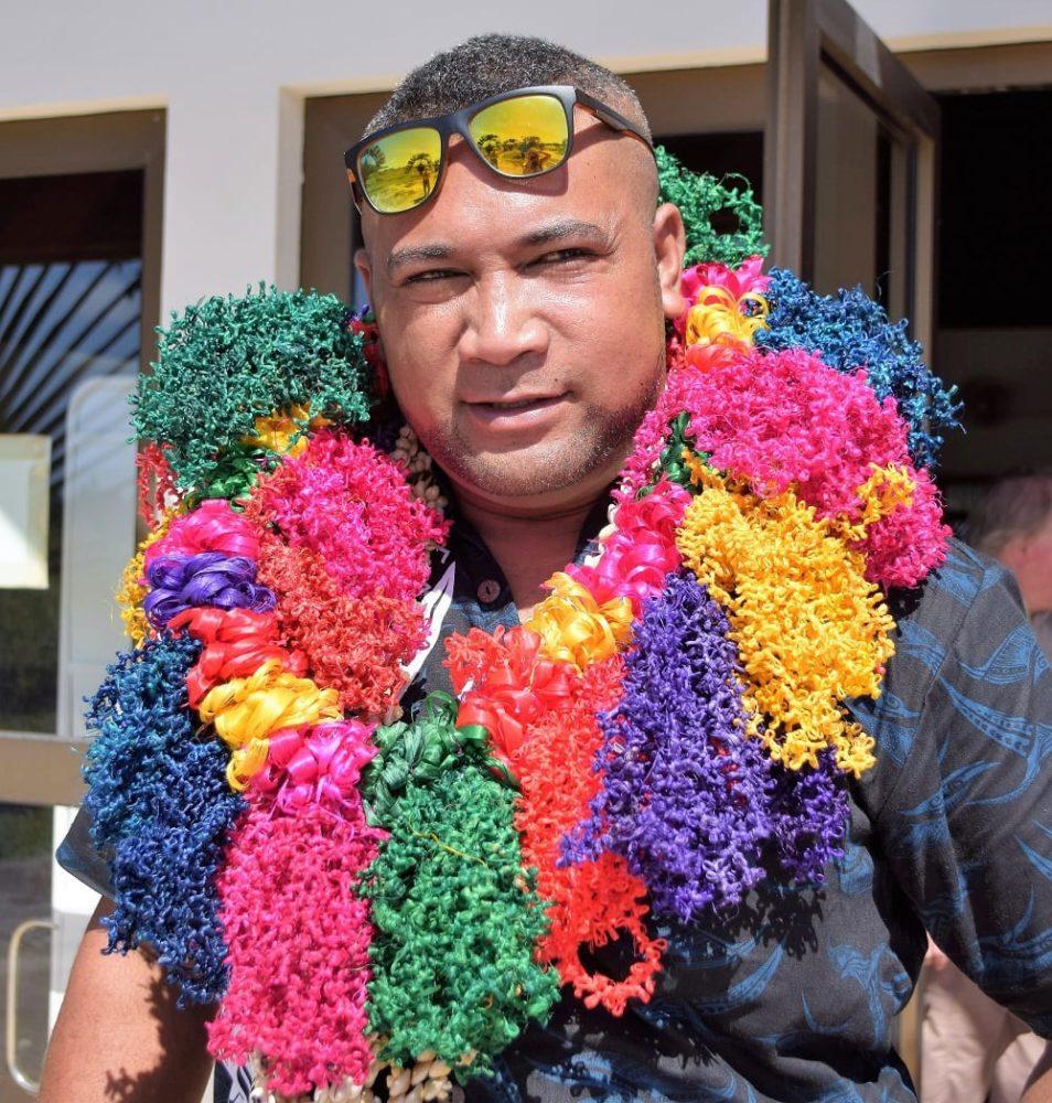 Wallisian man wearing a flower garland