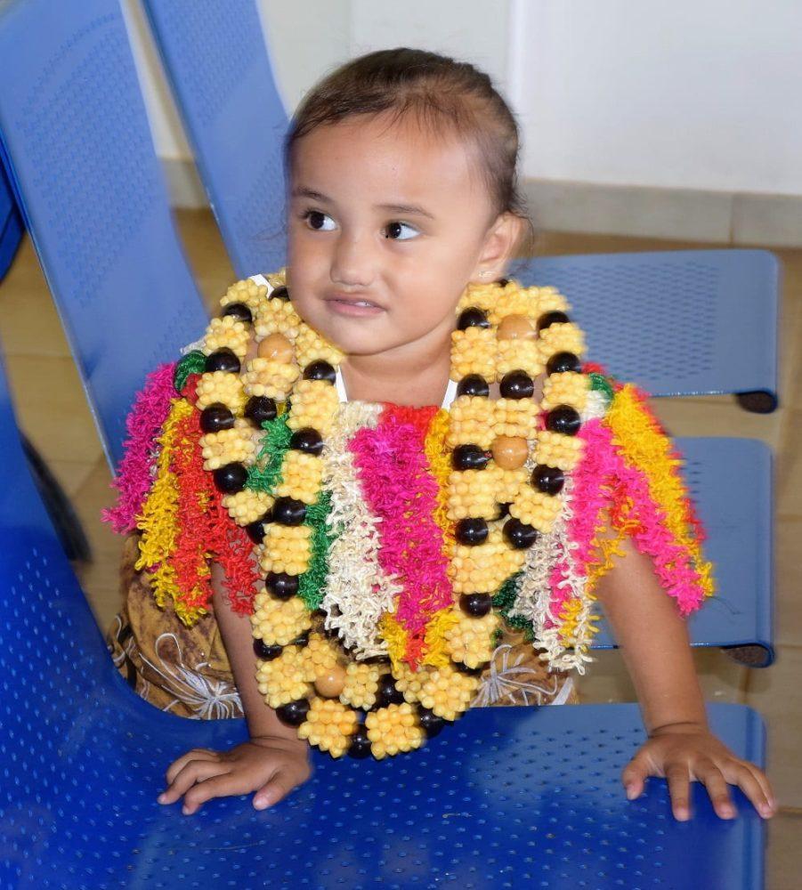 Wallisian toddler wearing a flower garland