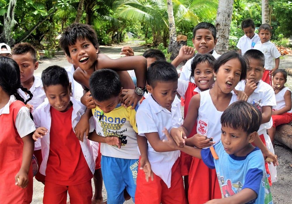 Schoolchildren crowding together in their playground