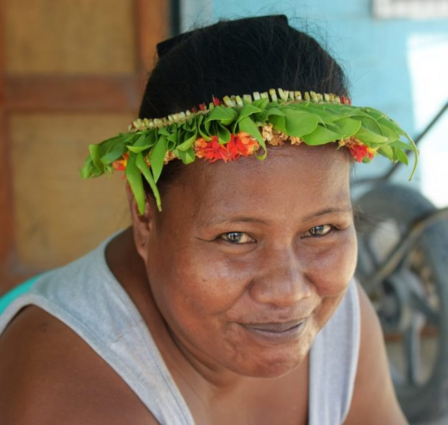 Portrait of a lady with a flower headdress at the market in South Tarawa Kiribati