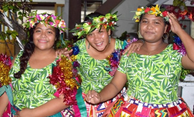 Female dancers attired in floral headdresses on Tuvalu