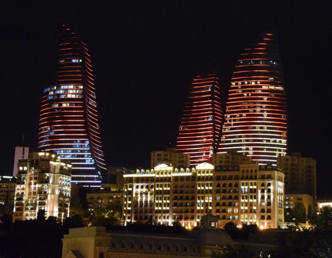 A view of The Flames , towers, in Baku lit red at night