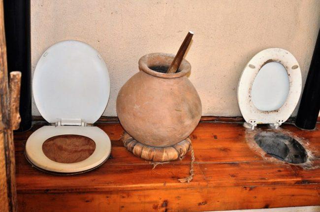 Side by side long drop toilets in Rwanda