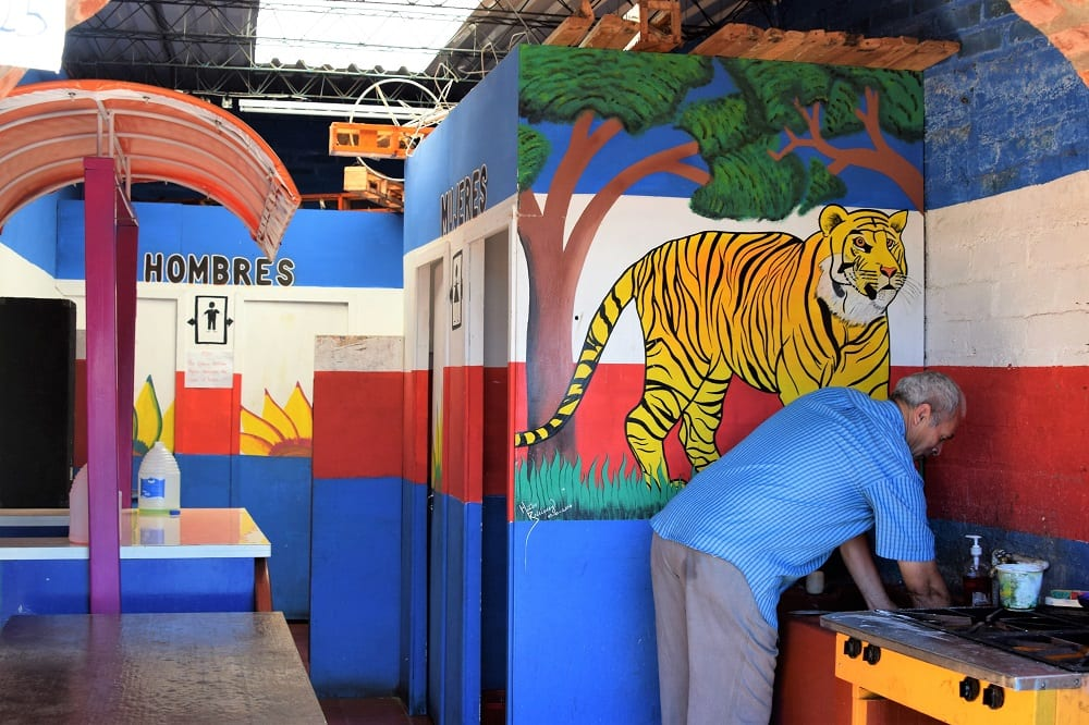 A red white and blue jungle themed toilet with a huge tiger in El Salvador