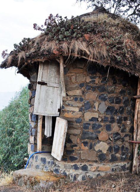 A long drop toilet on an escarpment edge in Ethiopia - great views
