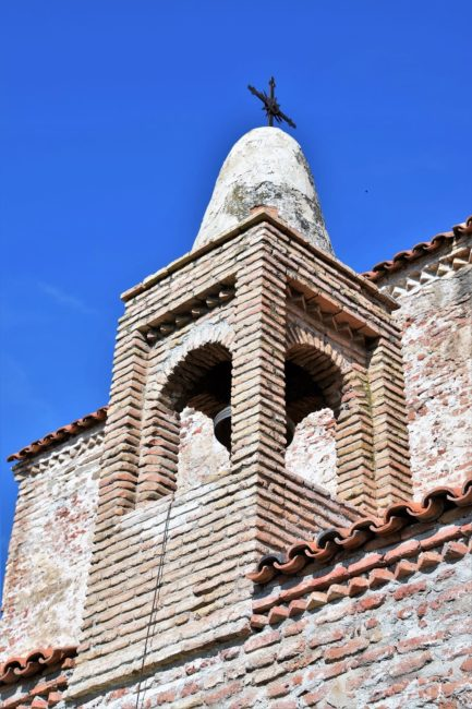 A view up the tower of an ancient brick church in Georgia