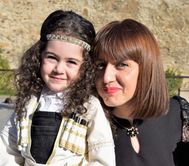 Mother and daughter dressed for a wedding at Mtskheta, Georgia