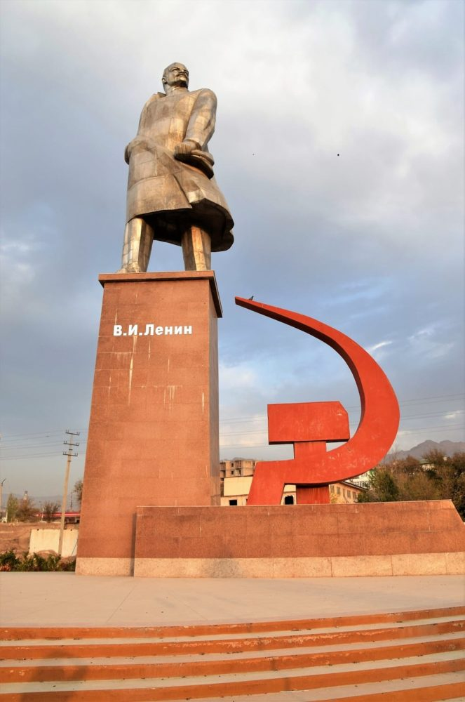 A statue of Lenin with hammer and sickle in Khujand