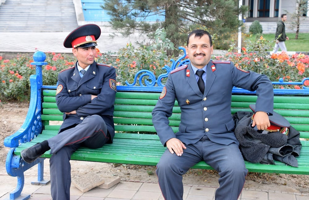 Soldiers in uniform on a bench in the park in Dushanbe