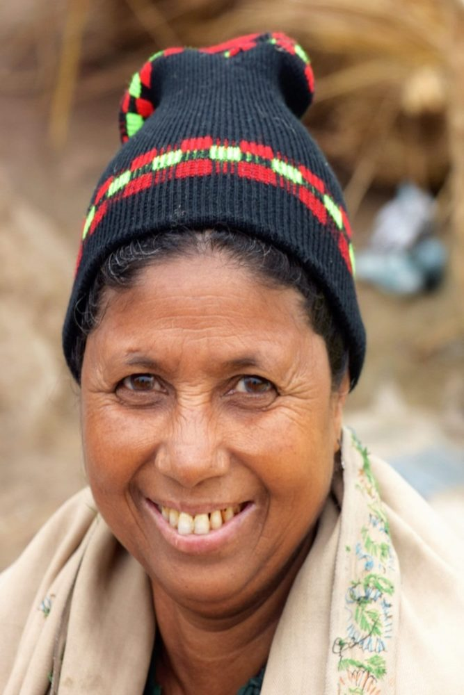 Portrait of a smiling Bangladeshi lady wearing a black patterned beanie