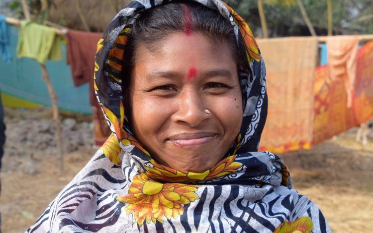 Portrait of a smiling young Bangladeshi lady wearing a black patterned headscarf