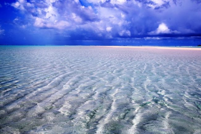 Ripples in the sand under shallow water leading to a sand bar at Kayangel Atoll