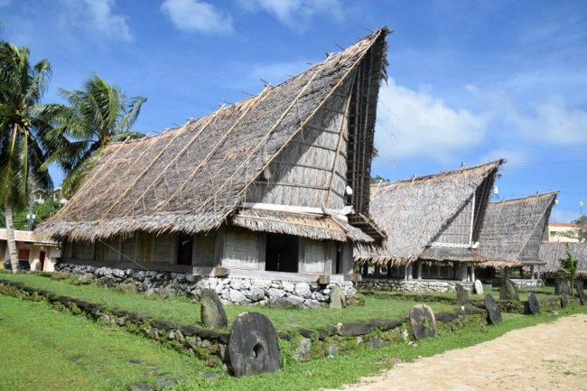 A row of longhouses with classic pointed roofs