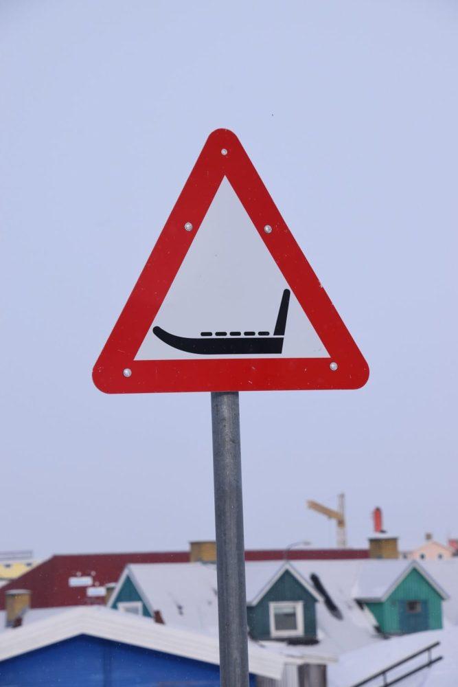 A road sign warning of toboggans in Ilulissat