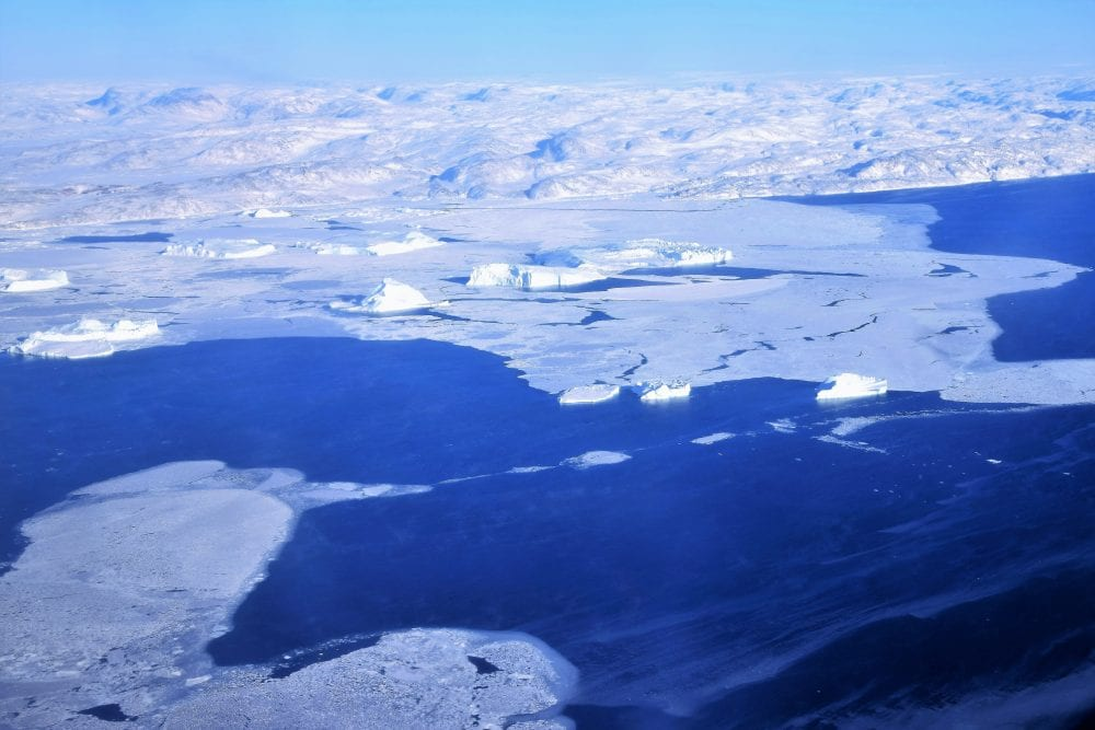 Floating ice and icebergs from the air in the Arctic Circle