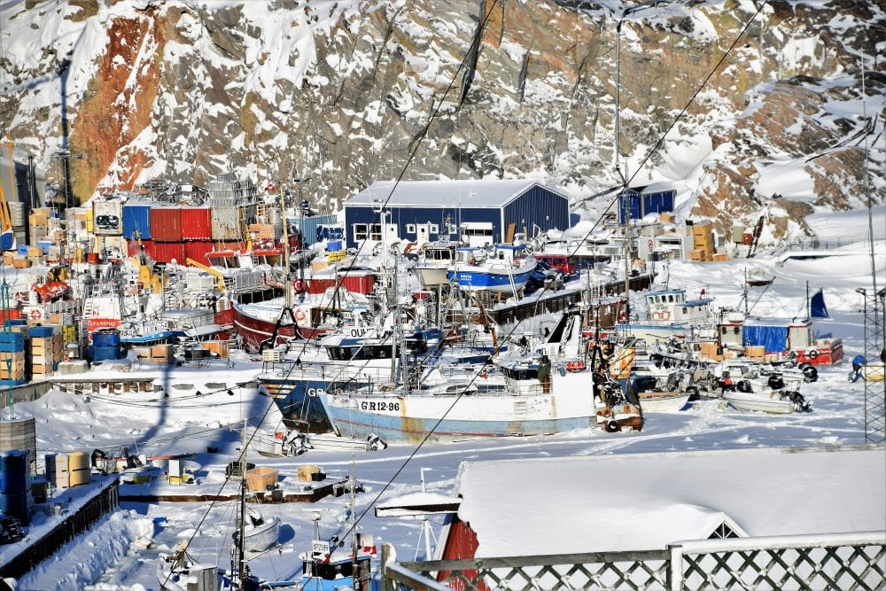 Icebound boats in the harbour at Ilulissat, Greenland
