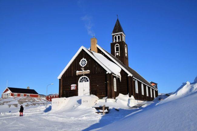 A dark wood timber church in Ilulissat, Greenland