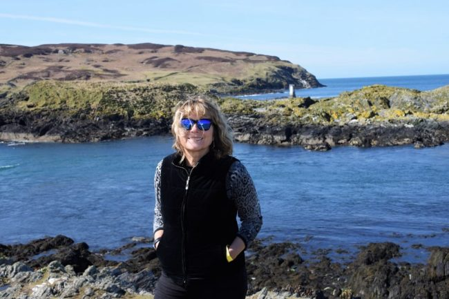 Sue on the shore, the calf of Man in the background