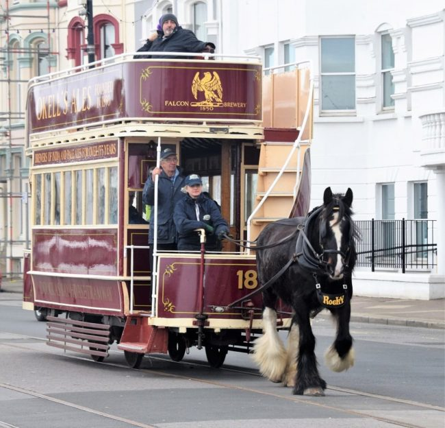 A horse drawn double decker bus on the esplanade at Douglas
