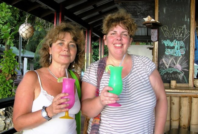 Sue with Sara drinking garish coloured cocktails
