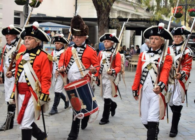 Scarlet uniformed 'soldiers' at the re-enactment parade
