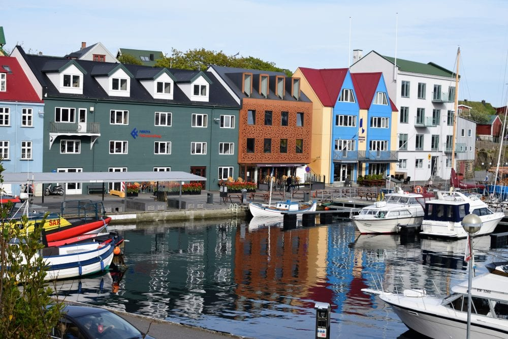 Bright colorbred houses reflected in the water of the harbour at Torshavn, Faroe Islands