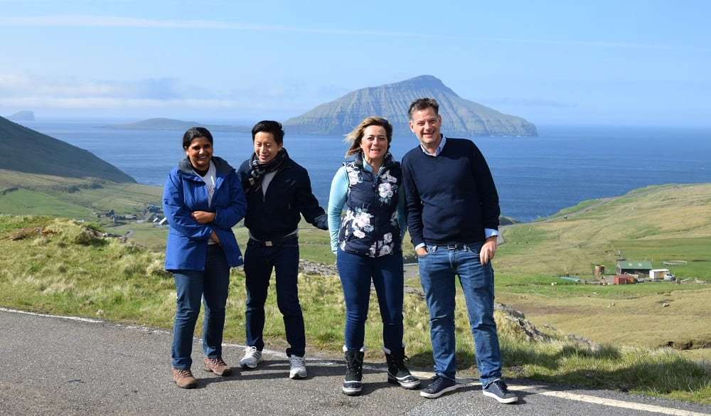 Sue and the van tour group at a fjord viewpoint, Faroe Islands