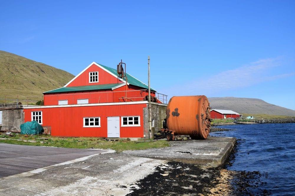 Bright scarlet buildings by the sea, Faroe Islands