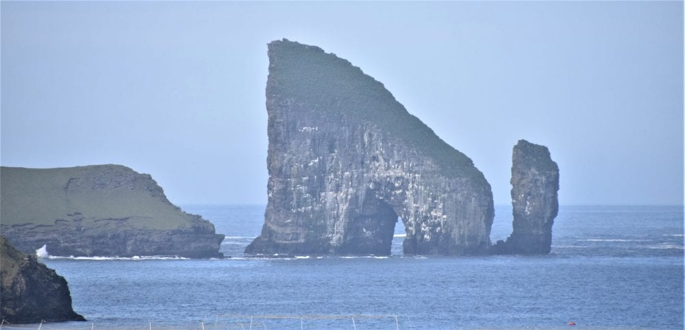 An arch and stack in the mist at Vestmanna Bird Cliffs