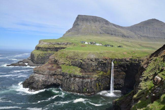 Mulafossur Waterfall dropping into the sea, Vagar Island