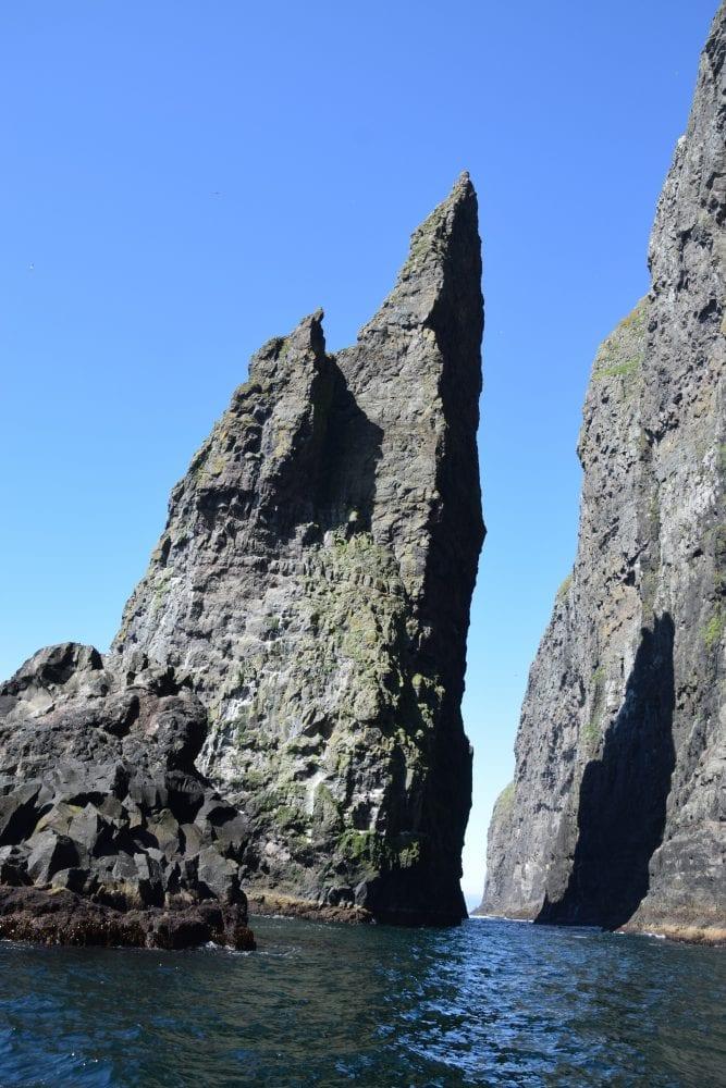 Jagged and towering rock pinnacles at Vestmanna Bird cliffs