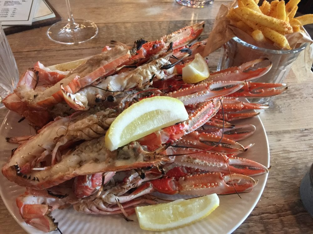 A plate of langoustines and a glass of fries