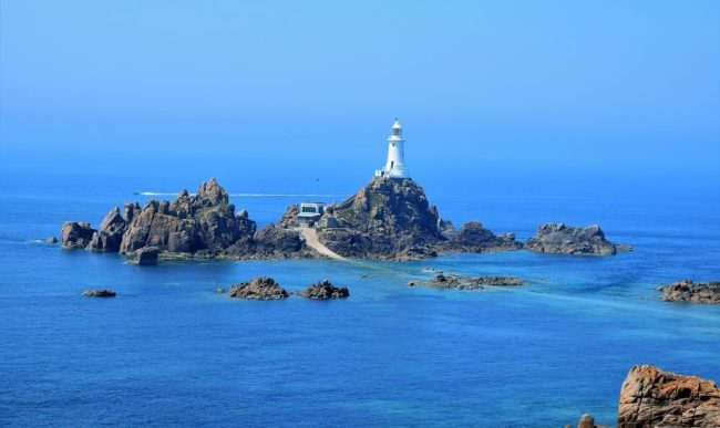 Beautiful Corbiere Lighthouse on the rocks, sitting on an ultramarine sea