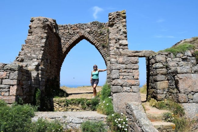 Sue, under a stone arch in the ruins of Grosnez Castle