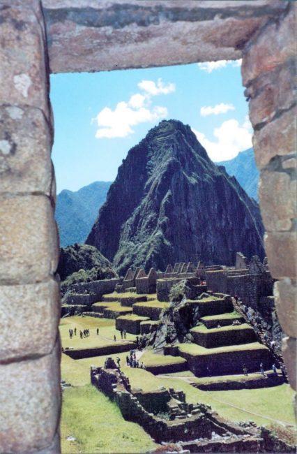 Huayna Picchu peak seen through a gate at Machu Picchu