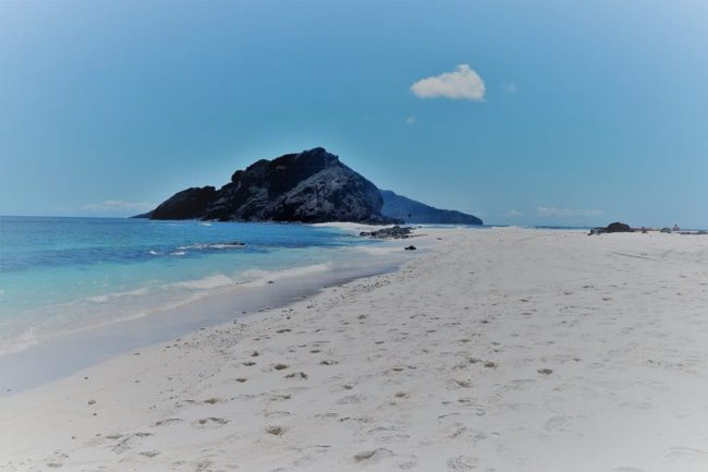 A glorious white sand islot beach with another islot offshore in Mayotte