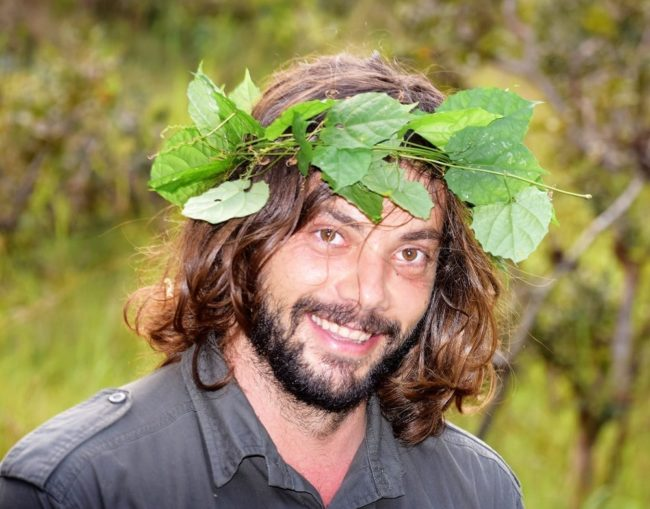 An Odzala guide sports a leafy wreath on his head