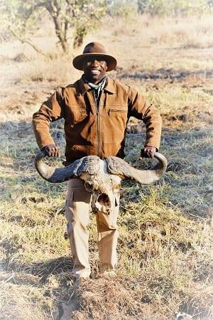 Vic holding a buffalo skull